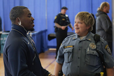 students speaking with law enforcement