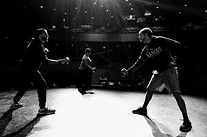 """Fight Director Andrew D. Ray choreographs a sequence in """"Romeo and Juliet"""" with Sterling community member Shane Rogers '15 (right) as Mercutio and Sterling College student Isaac Peña of Dodge City, Kansas, (center) as Tybalt."""