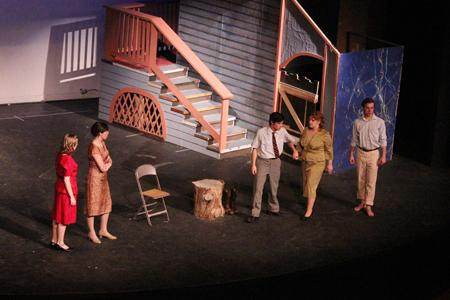 The actors and actresses rehearse a scene from Picnic during tech week.